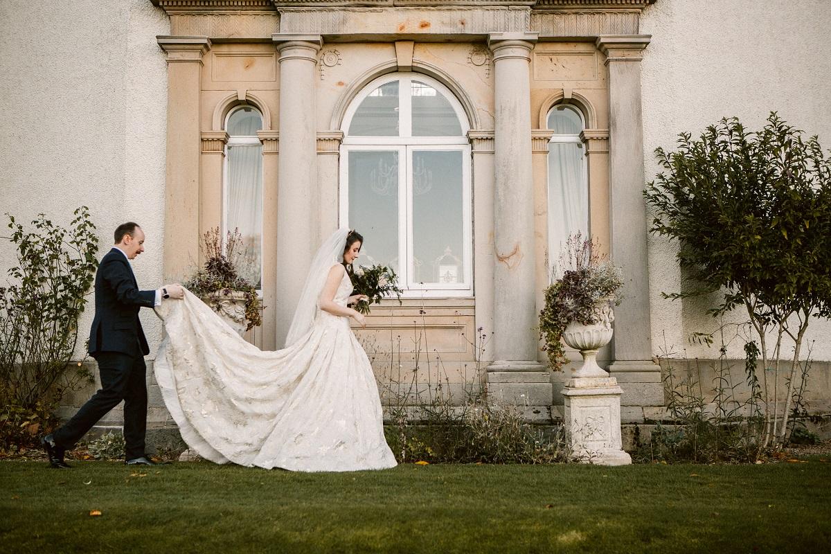 Bride and Groom Walking Around Manor House